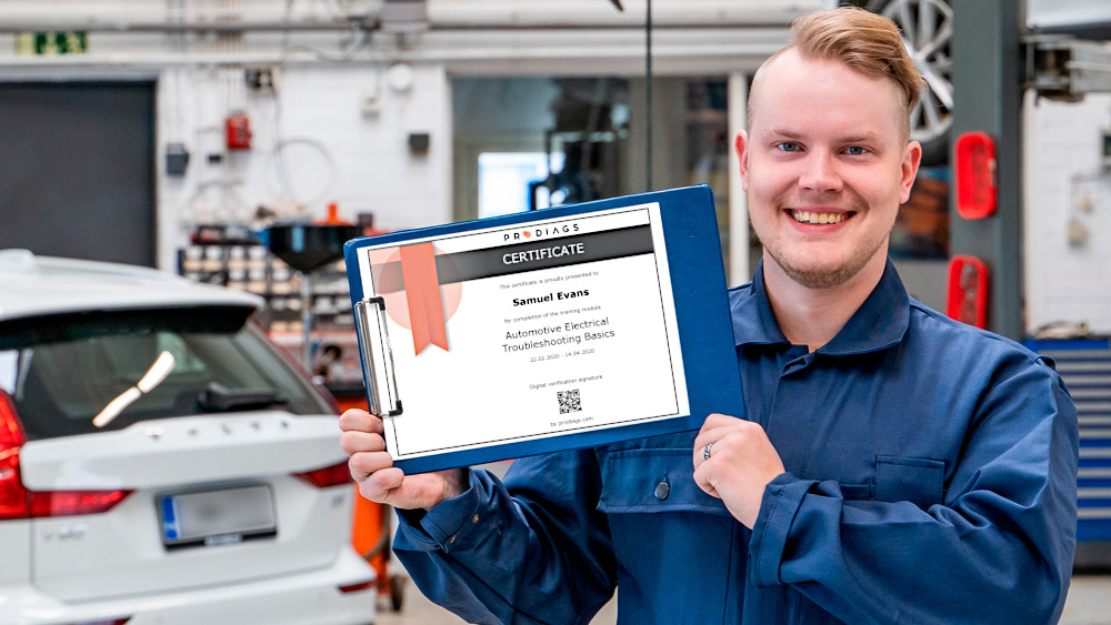 Proud and smiling car mechanic or technician presenting Prodiags Online Training Certificate