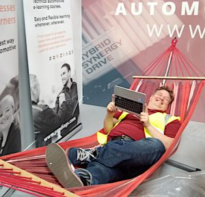 Automotive technology learner chilling in hammock while studying with Prodiags