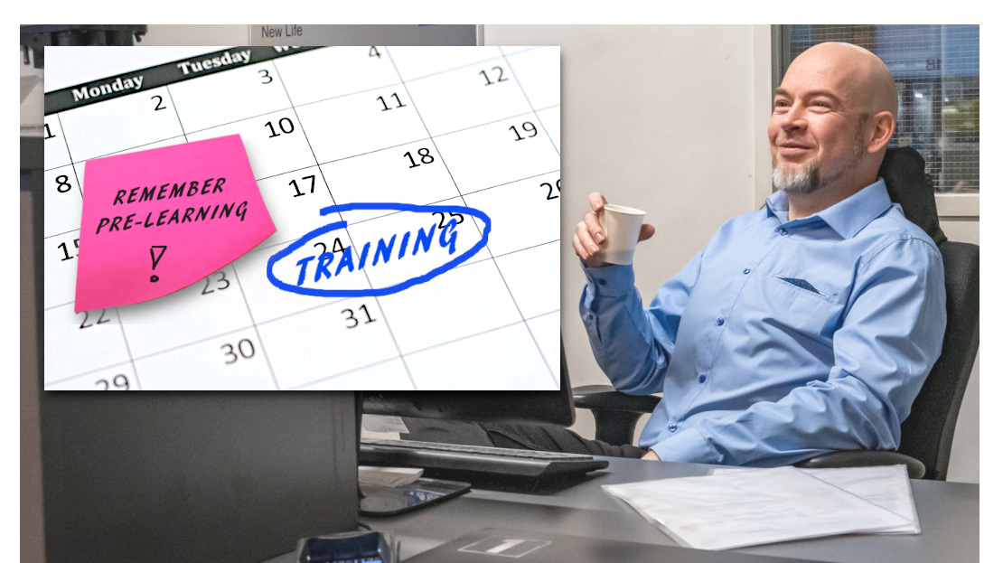Car garage or automotive workshop manager or owner drinking coffee in office. Bald man with gray beard in a blue button-up shirt holding a paper coffee mug. Planning the Prodiags Pre-Learning training concept for his mechanics and technicians before their face-to-face automotive tech training course. In the image a picture of a calendar with the texts training and remember pre-learning.